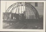 Three Men and Metal Dome Frame