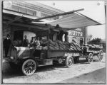 Transporting fruit for canning by open truck, circa 1925
