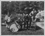 Sherman, Clay and Co. publicity photo with giant banjo, circa 1925