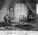 Interior of Fuller house showing Col. Fuller in front room, 1903