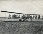 Ed Galloway and Frank Caillot with Biplane, circa 1918-1938