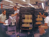 Men Working on Large Circuit Panels, circa