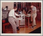 Dean John Drahmann with student in Physics Lab in Montgomery Laboratories, circa 1963